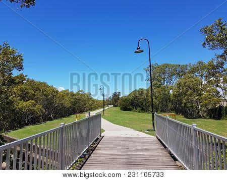 A Road Between Mangrove Swamps. North Lakes, Queensland, Australia