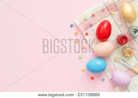 Flat Lay Top View Colorful Easter Egg Painted In Pastel Colors Composition With Paint Brush On Pink