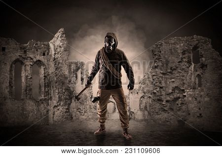Hazard, menace man in a ruined crumbly building with arms on his hand
