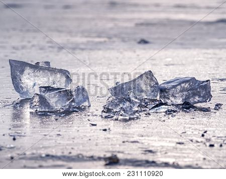 Shining Shards Of Broken Ice. Abstract Still Life Of Ice Floes On Lavel Of Frozen Lake.