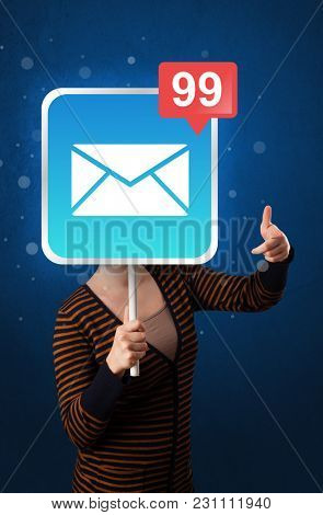 Casual young woman holding square sign with mail icon