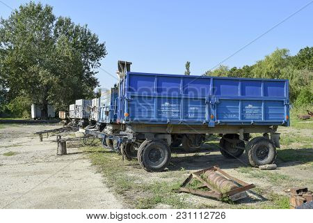 Russia, Temryuk - 15 July 2015: Trailers Trucks For A Tractor. The Trailer For Cargo Transportation.