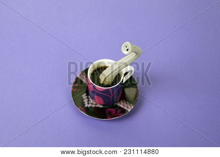 An Elephant Trunk Emerging From A Small Design Cup Of Coffee As If He Were Hiding. Minimal Funny And