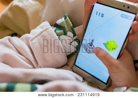 Zhongshan,china-february 15,2018:kid Playing A Mobile Game Called Little Jump Within Wechat Own By T