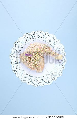 A Quirky Birthday Chicken Thigh Covered With Sprinkles Like Cake On Blue Pastel Background. Minimal