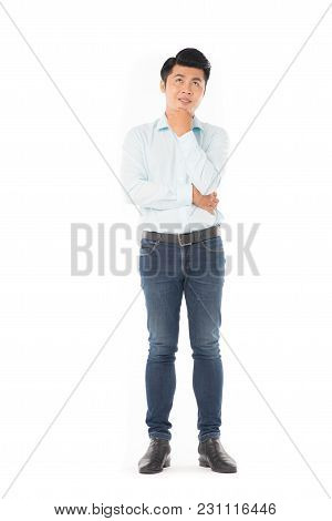 Studio Portrait Of Young Asian Man Expressing Emotions On White Background