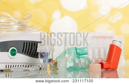 Two Types Of Inhalation Devices, Children's Mask And Liquid For Inhalation, On Yellow Background