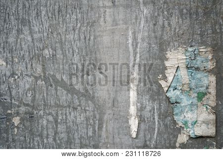 Torn Poster After Vote On Tin Textured Wall Ripped Newspaper