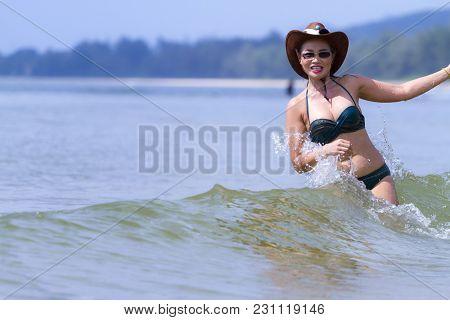 Woman And Bikini Beautiful Play Wave On Beach At Bang Beot Beach, Chumphon Province Thailand