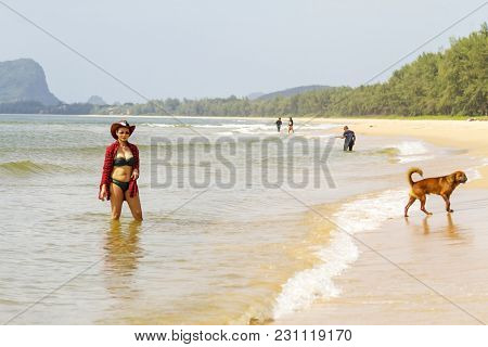 Woman With Sexy Bikini And Dog Outdoor On Beach At Bang Beot Beach, Chumphon Province Thailand