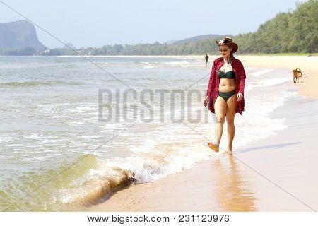 Woman Pretty Bikini And Hat Relax Daylight On Beach At Bang Beot Beach, Chumphon Province Thailand