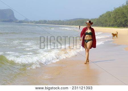 Woman Pretty And Bikini Relax Daylight On Beach At Bang Beot Beach, Chumphon Province Thailand