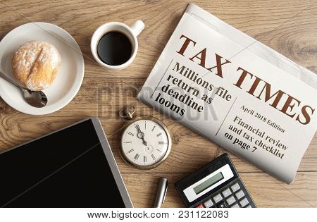 Tax Times Mock Up Newspaper With Clock, Calculator And Tablet