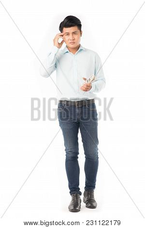 Portrait Of Young Asian Man Holding Dollar Bills