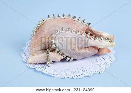 Playful Mashup Using A Chicken And Punk Spikes On A Blue Background. Minimal Color Still Life And Qu