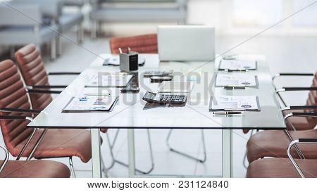 Financial Charts, Calculators, Notebook And Pens Laid Out On The Desktop Before Starting Business Ne