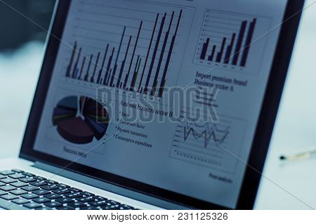 Closeup Of The Laptop Screen With Financial Chart On A Workplace Of The Businessman