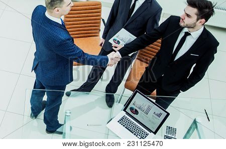 Assistant With Financial Documents And Business Partners Shake Hands Before Starting A Business Meet