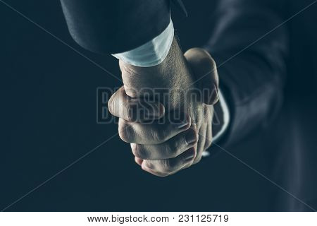 Close-up Of Handshake Of Business Partners On A Black Background.the Photo Has A Empty Space For You