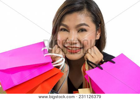Young Asian Woman Smiles With Fun And Exciting For Shock Sale Promotion, With Shopping Bag, Fun And