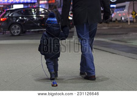 Two Years Toddler With Father Walking On Brodway In Manhattan In The Evening