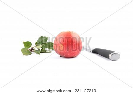 Colorful And Crisp Image Of Apple With Knife And Leaves On White