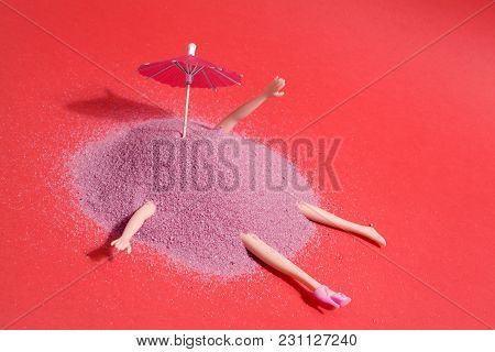 Doll And Pink Sand