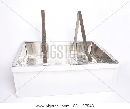 Colorful And Crisp Image Of Plastic Uncapping Tub And Sieve On White