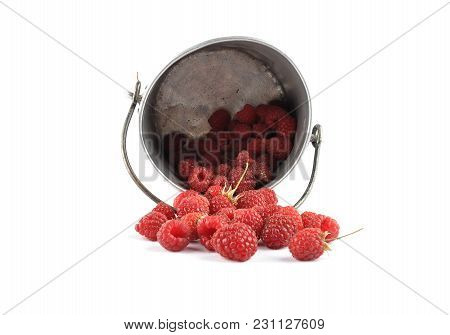 Colorful And Crisp Image Of Raspberries And Tin Bucket On White