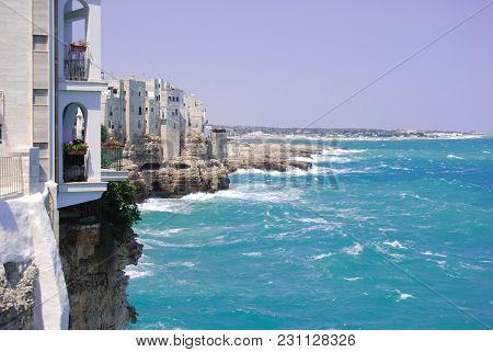 Overlooking The Sea Of Polignano A Mare With White Houses And Rough Sea