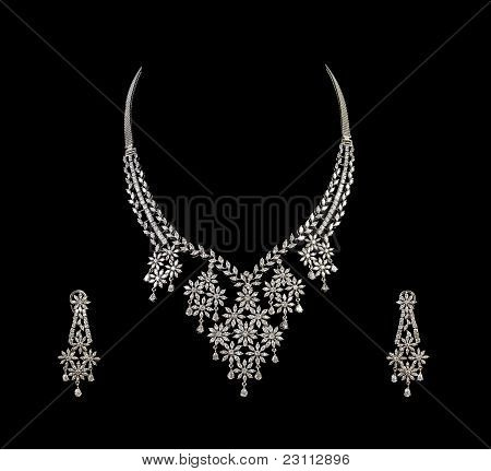 Close up of diamond necklace with diamond ear ring