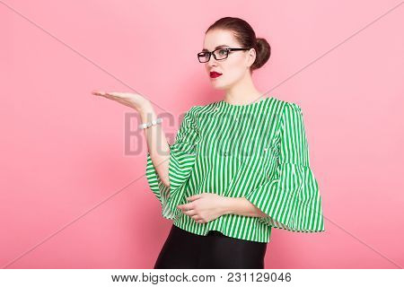 Portrait Of Attractive Cheerful Businesswoman With Hair Bun In Striped Blouse And Eyeglasses Present