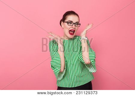 Portrait Of Attractive Businesswoman With Hair Bun In Striped Blouse And Eyeglasses With Surprised F