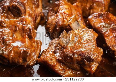 Pork Spare Ribs On Dish In Own Sauce