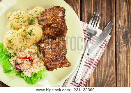 Pork Spare Ribs Served With Mashed Potatoes And Sauce. Ready For Eat. Top View