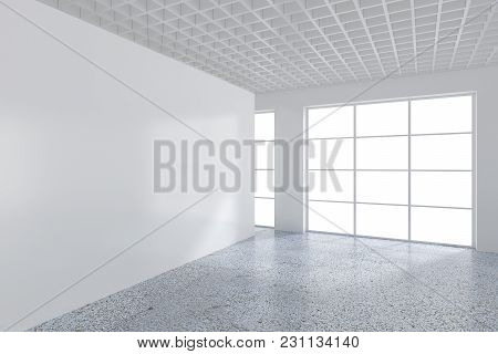 White Billboard In An Empty Office With Large Windows And Beautiful Diffused Light From The Window.