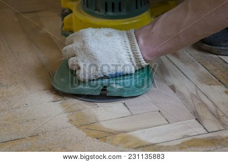 Renovation Of An Old Wooden Parquet Floor With Grinding Machine