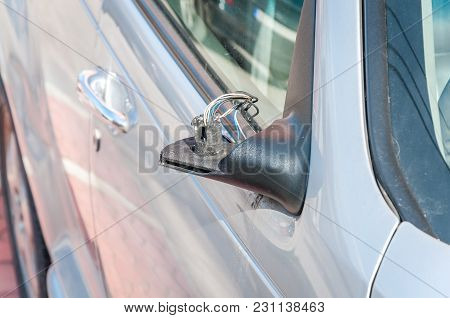 Damaged Car. Broken And Damaged Side Mirror On The Car Doors With Remaining Wires