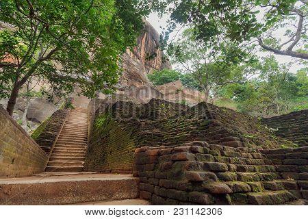 Grunge Stone Stairs To Ancient Sigiriya Rock With Archeological Area, Sri Lanka. Unesco World Herita