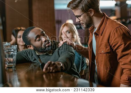 Very Drunk African American Man With Automobile Keys At Bar With Friends