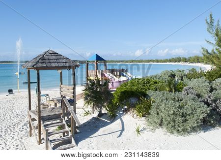 Tourist Beach Wooden Structures On Otherwise Uninhabited Island Half Moon Cay (bahamas).