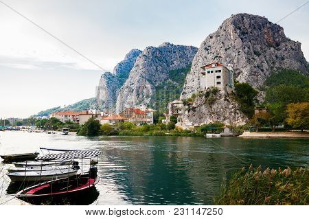 Boats On The River Cetina In The Small Town Omis