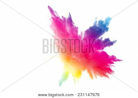 Abstract Multicolored Powder Explosion On White Background.  Freeze Motion Of Color Dust  Particles