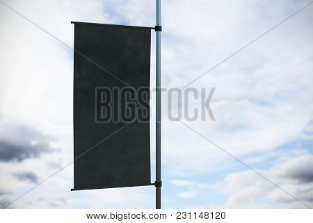 Empty Black Rectangular Flag Banner On Bright Sky Background. Advertisement And Commercial Concept.