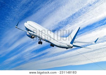 Airplane Flying In The Blue Sky, Travel Background With Commercial Flying Airplane With Blank Livery