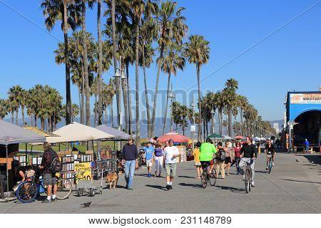 Venice, United States - April 6, 2014: People Visit Ocean Front Walk At Venice Beach, California. Ve