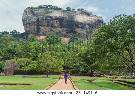 Lonely Woman In Headscarf Walking To Famous Landmark Sigiriya Rock With Green Trees Forest Around, S