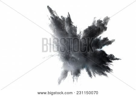 Black Powder Explosion Against White Background.the Particles Of Charcoal Splattered On White Backgr