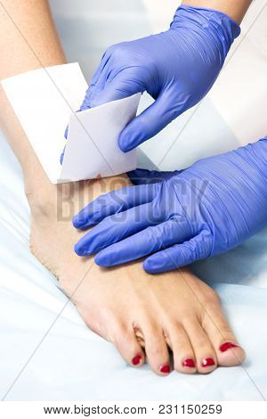 The Process Of Classical Wax Depilation Of Female Limbs In The Beauty Salon.