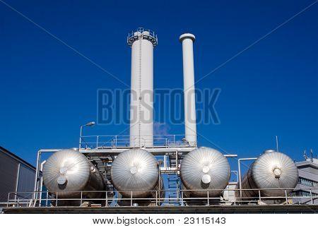 Silver tanks with smokestacks
